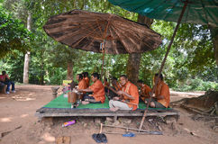 Musicians in Cambodia. Unidentified musicians, victims of anti-personal mines, perform music near Angkor Wat in Cambodia royalty free stock photos