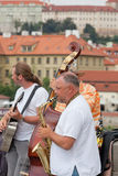 Musicians on Charles Bridge in Prague. The Czech Republic, July 30, 2013 .Its construction started in 1357 under King Charles IV royalty free stock photo