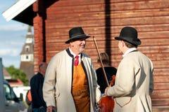 Musicians chat at Swedish folk music festival Stock Photo
