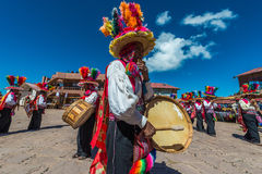 Musicians and dancers in the peruvian Andes at Puno Peru royalty free stock photography