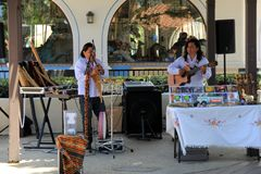 Musicians entertaining people passing by in outdoor shopping center, California, 2016. Talented musicians entertaining the crowd of the day in outdoor shopping Royalty Free Stock Photo