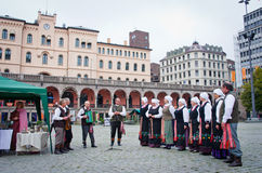 Musicians garbed in period costumes performing   in Oslo, Norway Stock Image
