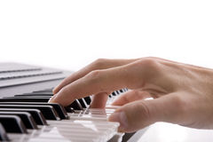 Musicians hand playing a piano Royalty Free Stock Images