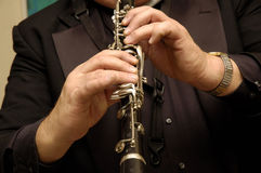 Musicians hands playing clarinet. Musicians hands playing his clarinet Stock Image