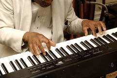 Musicians hands playing piano. Musicians hands playing his electric piano Stock Photo