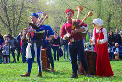 Musicians in historical costumes perform in a park Stock Photography