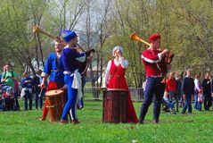 Musicians in historical costumes perform in a park Royalty Free Stock Photo