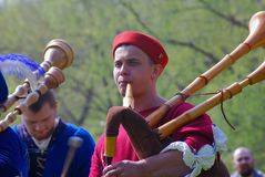 Musicians in historical costumes perform in a park Stock Photos
