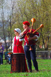 Musicians in historical costumes perform in a park Royalty Free Stock Photography