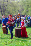 Musicians in historical costumes perform in a park Stock Photo
