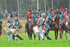Musicians and horse riders on the battle field Stock Photography
