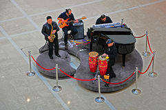 Musicians at ifc mall, hong kong. Musicians performing at the international finance center in hong kong to entertain the visitors Stock Image