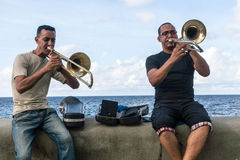 Musicians at Malecon. Havana, Cuba - 18 January, 2015 - two man playing trombone at Malecon Royalty Free Stock Photos