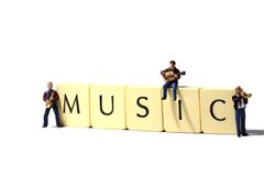 Musicians music B. Miniature models of musicians with tiles spelling music royalty free stock photo