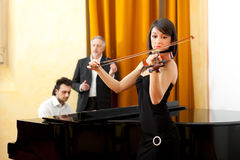 Musicians with a music teacher Royalty Free Stock Photography