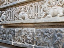 Musicians and mythical animals carved on the walls of Hoysaleshwara temple at Halebidu Royalty Free Stock Image