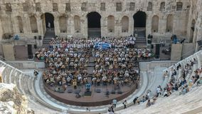 Musicians at the odeon of herodes atticus in athens, greece. Musicians prepare for a concert at the odeon of herodes atticus in athens, greece stock photos