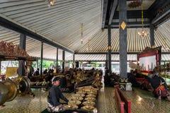 Musicians perfoming Gamelan music at King`s palace in Yogyakarta, Indonesia. Yogyakarta, Indonesia - October 2017: Musicians perfoming Gamelan music at King`s Royalty Free Stock Images