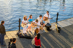 Musicians performing on the Inner-Harbour Pathway in Victoria Royalty Free Stock Photos