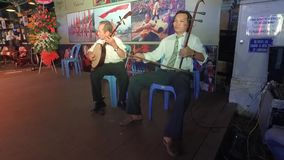 Musicians performing in Ho Chi Minh city in Vietnam. Musicians performing traditional music with traditional instruments in Ho Chi Minh city in Vietnam stock footage