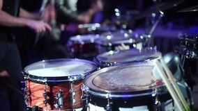 The musicians play on drums. A few guys are very passionate about playing drums stock video
