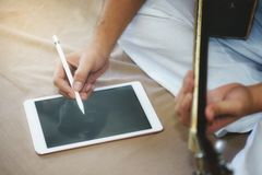 Musicians play guitar and compose songs using the tablet. royalty free stock image