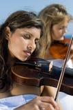 Musicians play violin Royalty Free Stock Photo