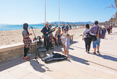 Musicians playing by the beach Stock Image