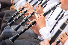 Musicians playing clarinet in street orchestra Stock Image