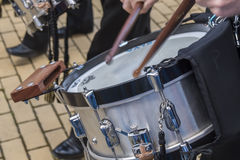 Musicians playing drums in a band Stock Image