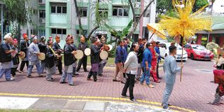 Malay wedding procession in Singapore. Musicians playing drums and percussion music at a Malay wedding procession in Toa Payoh housing estate, Singapore stock photography
