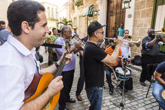Musicians playing Havana royalty free stock photography