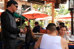 Musicians playing music while people enjoy lunch, Old Town, San Diego, California, 2016 Royalty Free Stock Photo