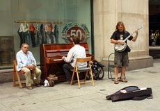 Musicians playing on street for money Stock Image