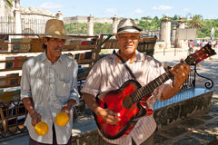 Musicians playing for tourists in Havana Stock Photo