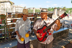 Musicians playing for tourists  in Havana Stock Image