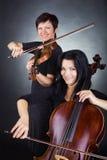 Musicians playing violin Stock Photo