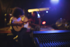 Musicians practicing with music equipment in nightclub Royalty Free Stock Photography
