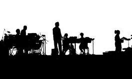 Musicians of rock band playing on iPads. In black and white silhouette Royalty Free Stock Photos