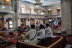 Musicians in the Sikh Temple. Sikh musicians are playing inside the Sikh temple at Paonta Sahib,india, a Sikh pilgrimage destination royalty free stock photo