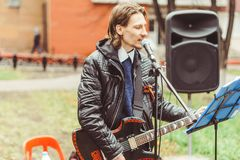 Musicians sing in the street. Musicians sing songs on the street on victory day Stock Image