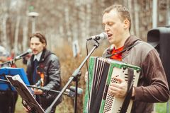 Musicians sing in the street. Musicians sing songs on the street on victory day Royalty Free Stock Image