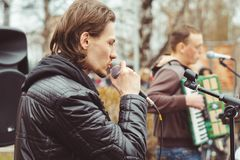 Musicians sing in the street. Musicians sing songs on the street on victory day Royalty Free Stock Images