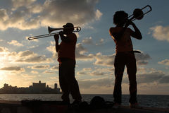 Musicians in the sunset of Malecon, in Havana. HAVANA, CUBA, FEBRUARY 15, 2014 : Musicians in the sunset of Havana. Havana is the largest city in the Caribbean Stock Photography