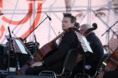 The musicians of the symphony orchestra. A concert of russian and european opera classics tribute to galina vishnevskaya. opera in the open air on the shore of stock photo