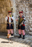 Musicians in traditional folk costumes Royalty Free Stock Photos