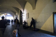 Musicians in the tunnels under the old Munich City Hall Royalty Free Stock Photography