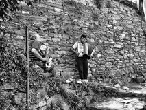 Musicians. Vernazza, Italy - July 2, 2014: two musicians along the trail that connects Vernazza with neighbouring villages in Cinque-Terre, Italy Stock Photography