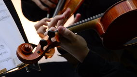 Musicians violinists playing violin or viola in a string quartet on a concert. Musician playing viola in a string quartet on a concert stock footage