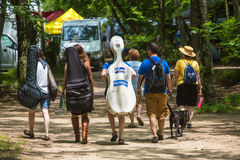 Musicians Walking at the Wild Goose Festival Royalty Free Stock Image